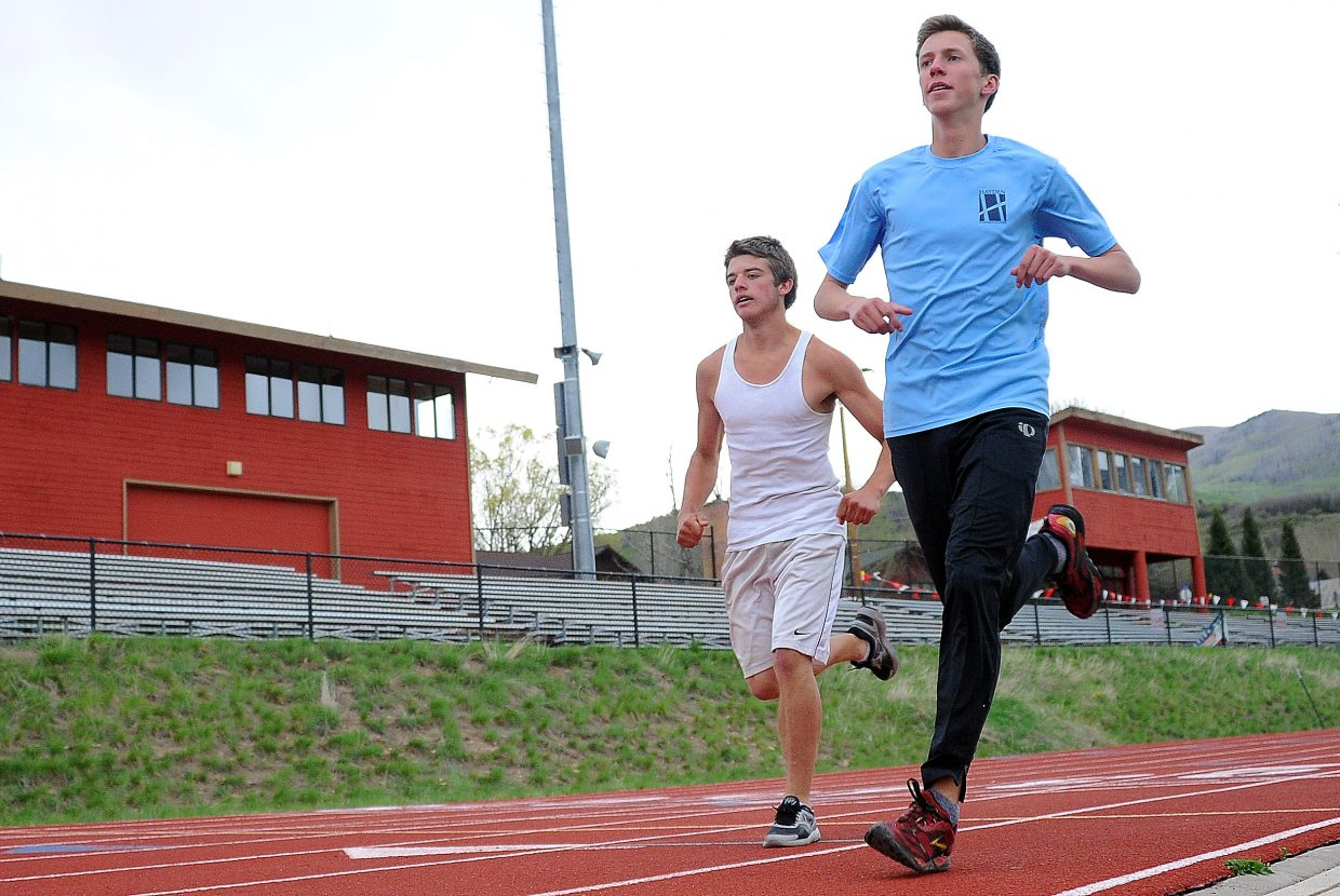 Steamboat's Tanner Morrison, left, and Asher Rohde train Thursday at Steamboat Springs High School. Each is hoping to improve enough in the next three weeks to earn a ticket to next month's state track meet.