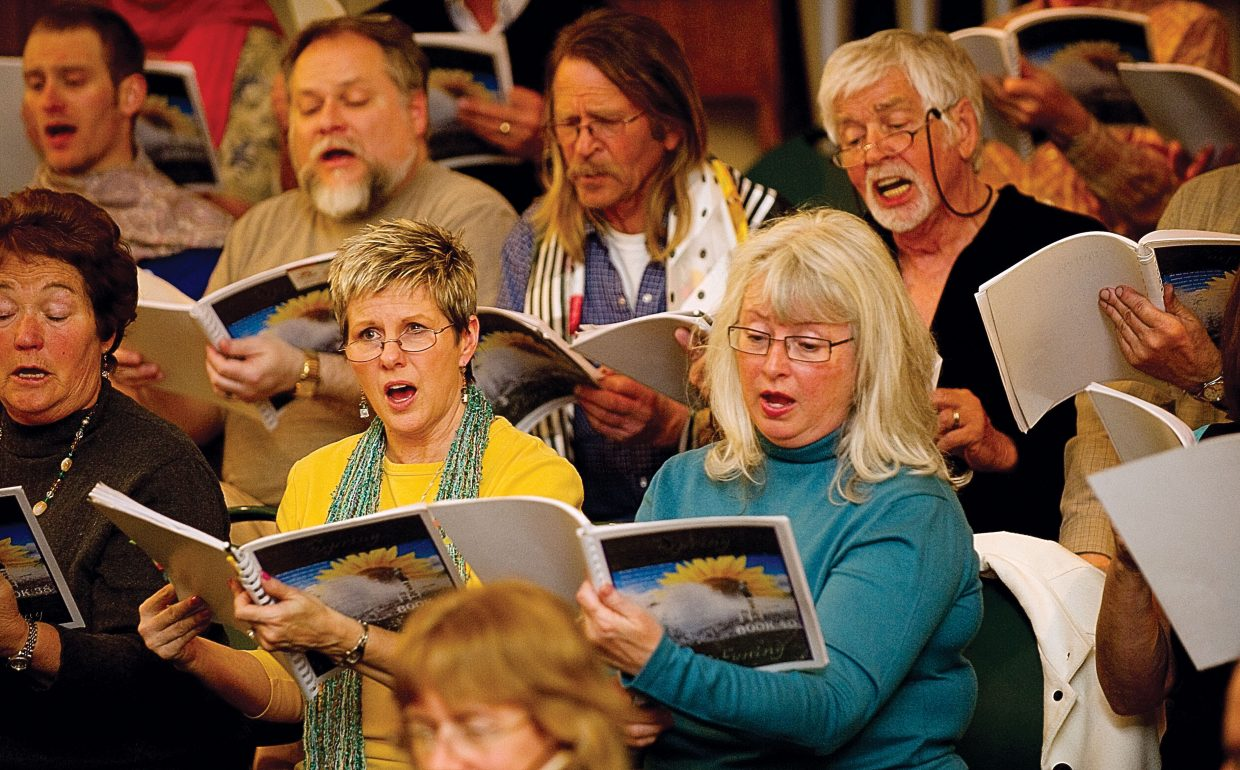 "Juli Montes, middle left, and Susie Hadden, middle right, sing during a rehearsal for ""Spring Awakening"" earlier this week at the United Methodist Church. The Yampa Valley Singers and Steamboat Chamber Singers, featuring the Steamboat String Quartet, will fill the United Methodist Church of Steamboat Springs during performances at 7 p.m. Saturday and 3 p.m. Sunday."
