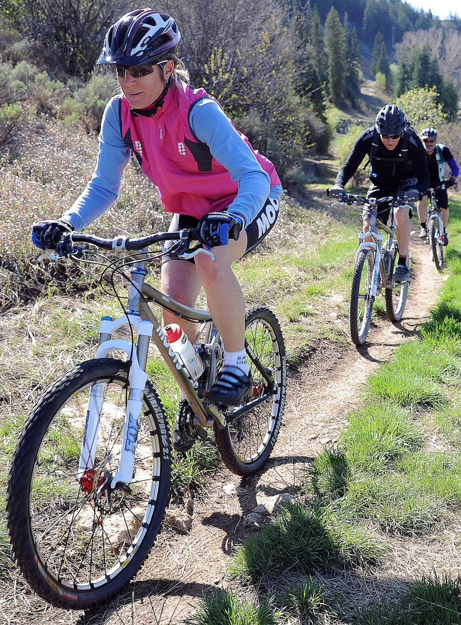 Cathy Wiedemer, Glenn Wiedemer and Dan Chovan pedal up Emerald Mountain on Saturday afternoon. They said they've been able to log plenty of road biking miles so far this spring but were excited to get in their first taste of Routt County dirt on their mountain bikes. Most of the lower trails on Emerald were declared open.