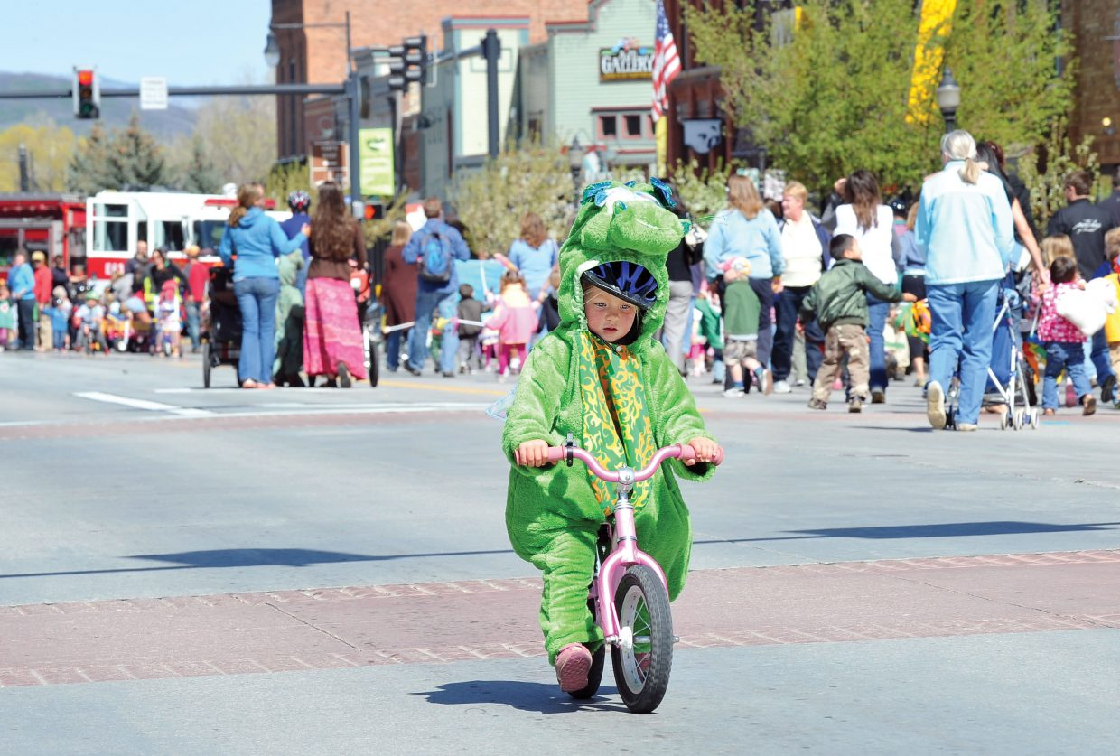 Tallulah Harms, 3, rides a strider bike during the annual Children's Parade in downtown Steamboat Springs on Monday morning. The parade was held as part of the celebration of the Month of the Young Child. Watch a video of the parade at SteamboatToday.com/videos.