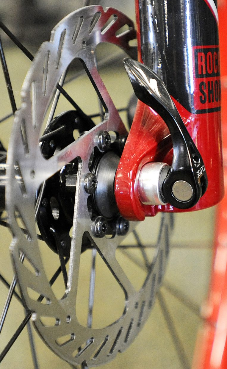 Disc brakes like these on a Specialized mountain bike at Ski Haus are among options that come with bikes as costs increase.