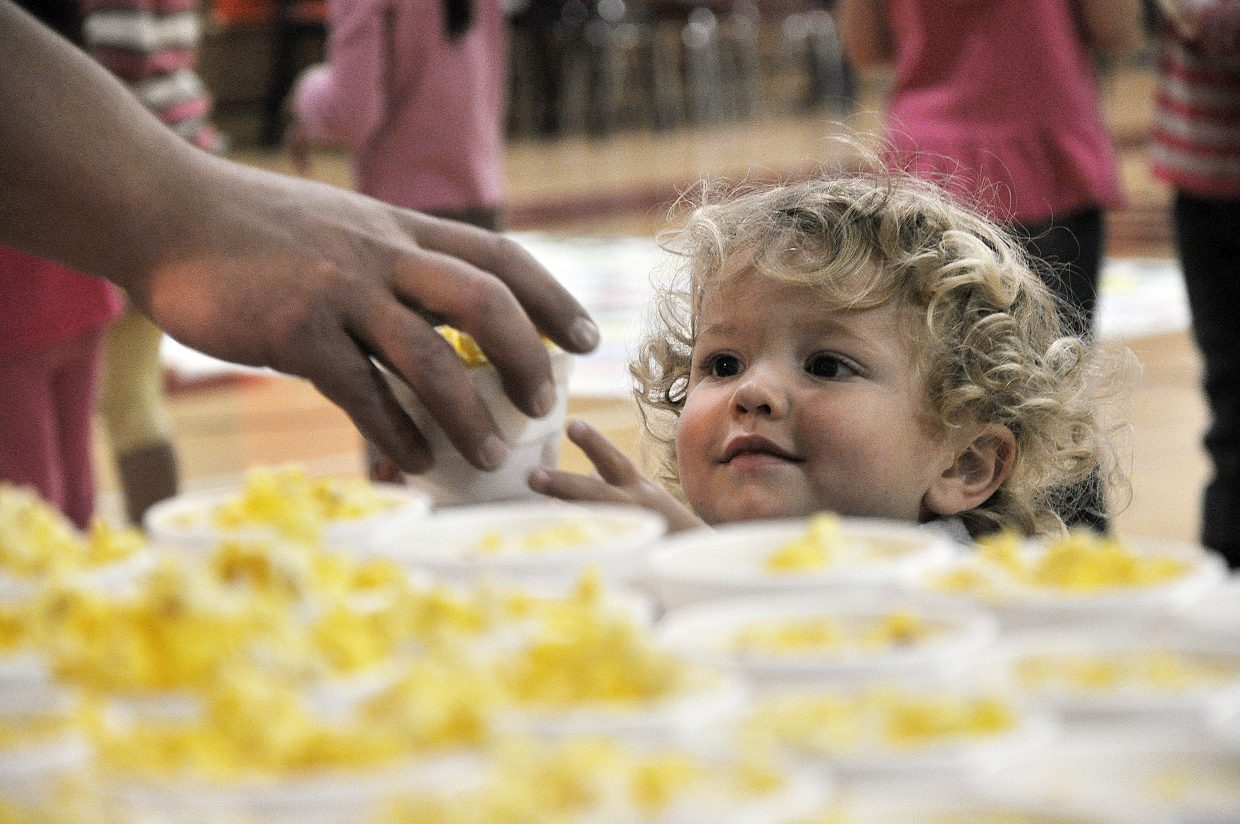 George Boisjoli grabs some popcorn Wednesday at Steamboat Springs High School's Kids Carnival. Preschoolers through second-graders enjoyed a number of games and events put on by the high school's leadership class.