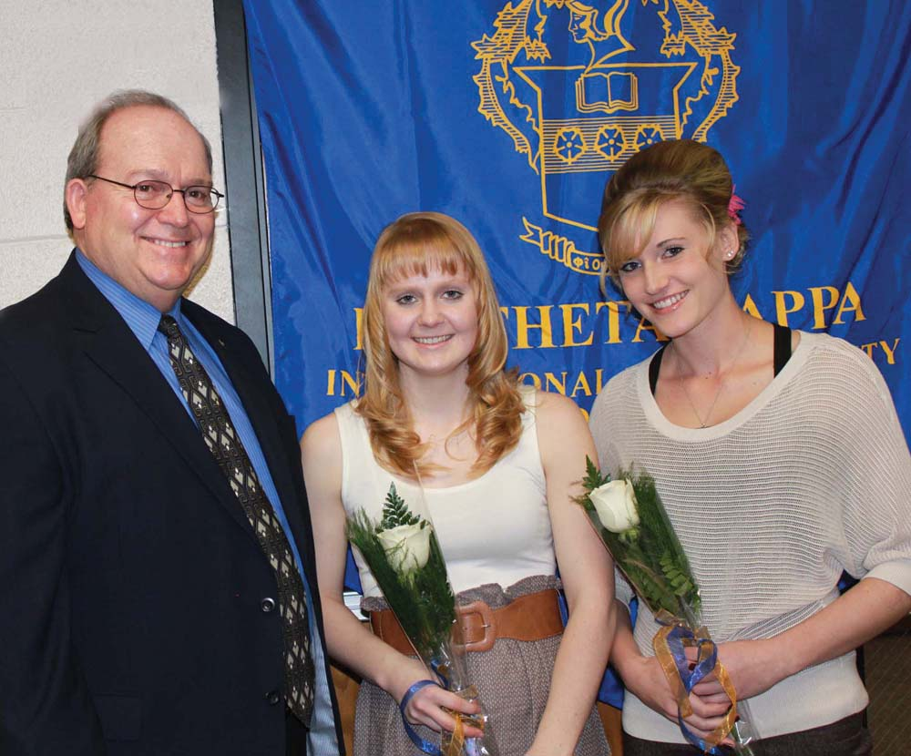 Colorado Northwestern Community College Rangely and Craig campus President Russel George, from left, stands with Caitlyn Berry, a 2010 graduate of Soroco High School, and Bryanna McFadden, a 2010 graduate of Hayden High School.