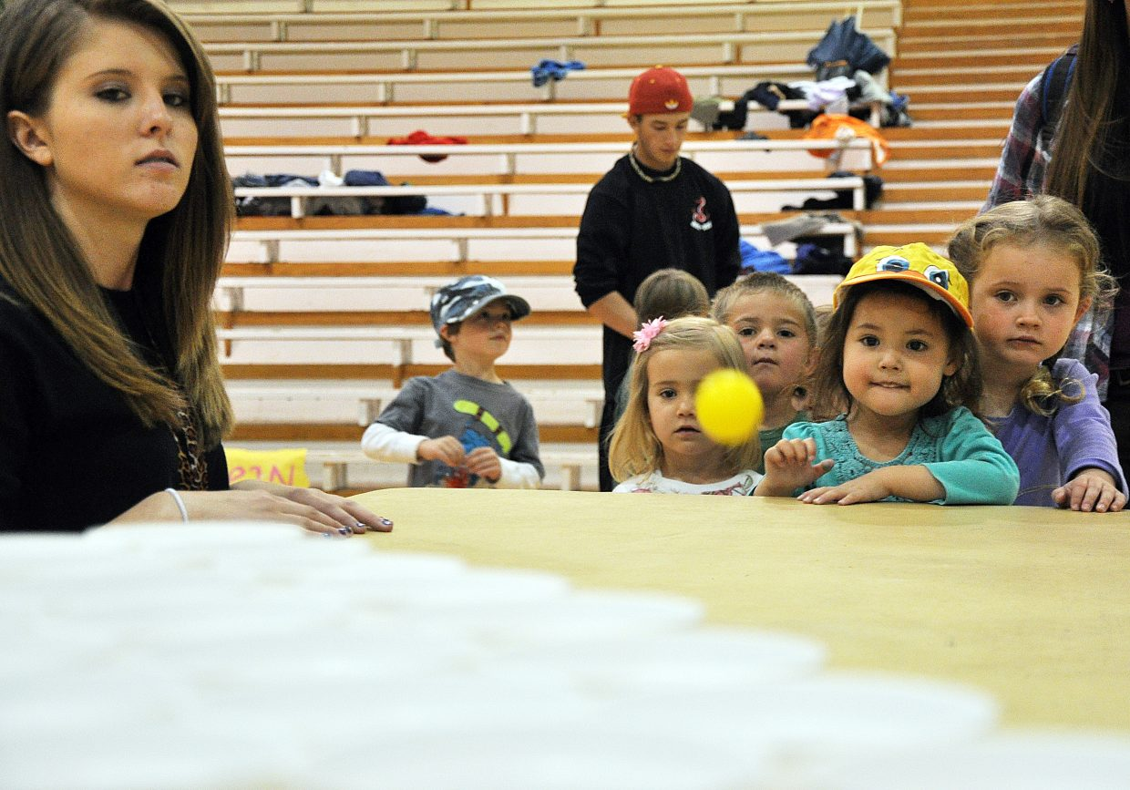 Shayla Edgerton, 3, throws a ping pong ball Wednesday at Steamboat Springs High School's Kids Carnival.