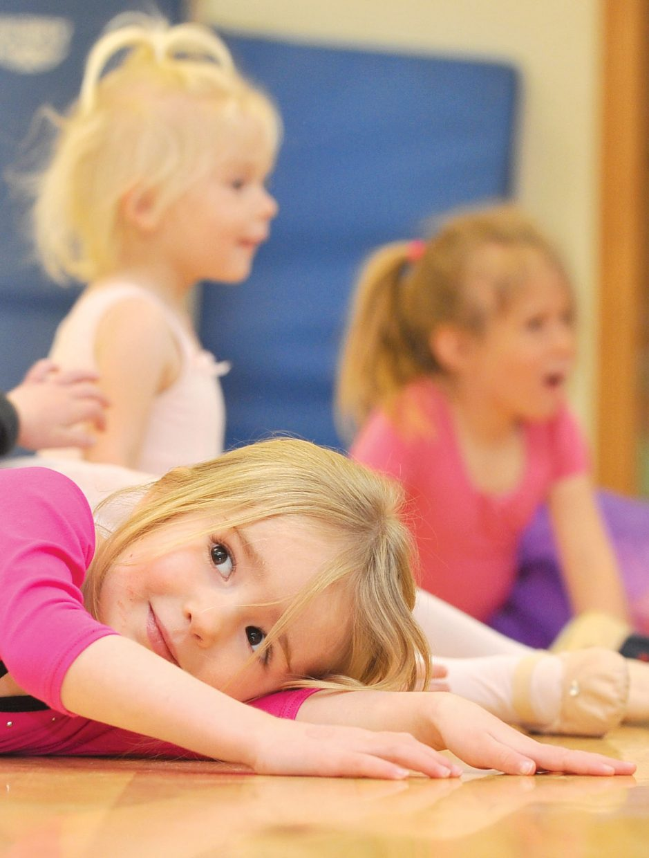 Josie Beckner saves her energy for dancing while rehearsing at the Let's Dance studio in Oak Creek Wednesday.