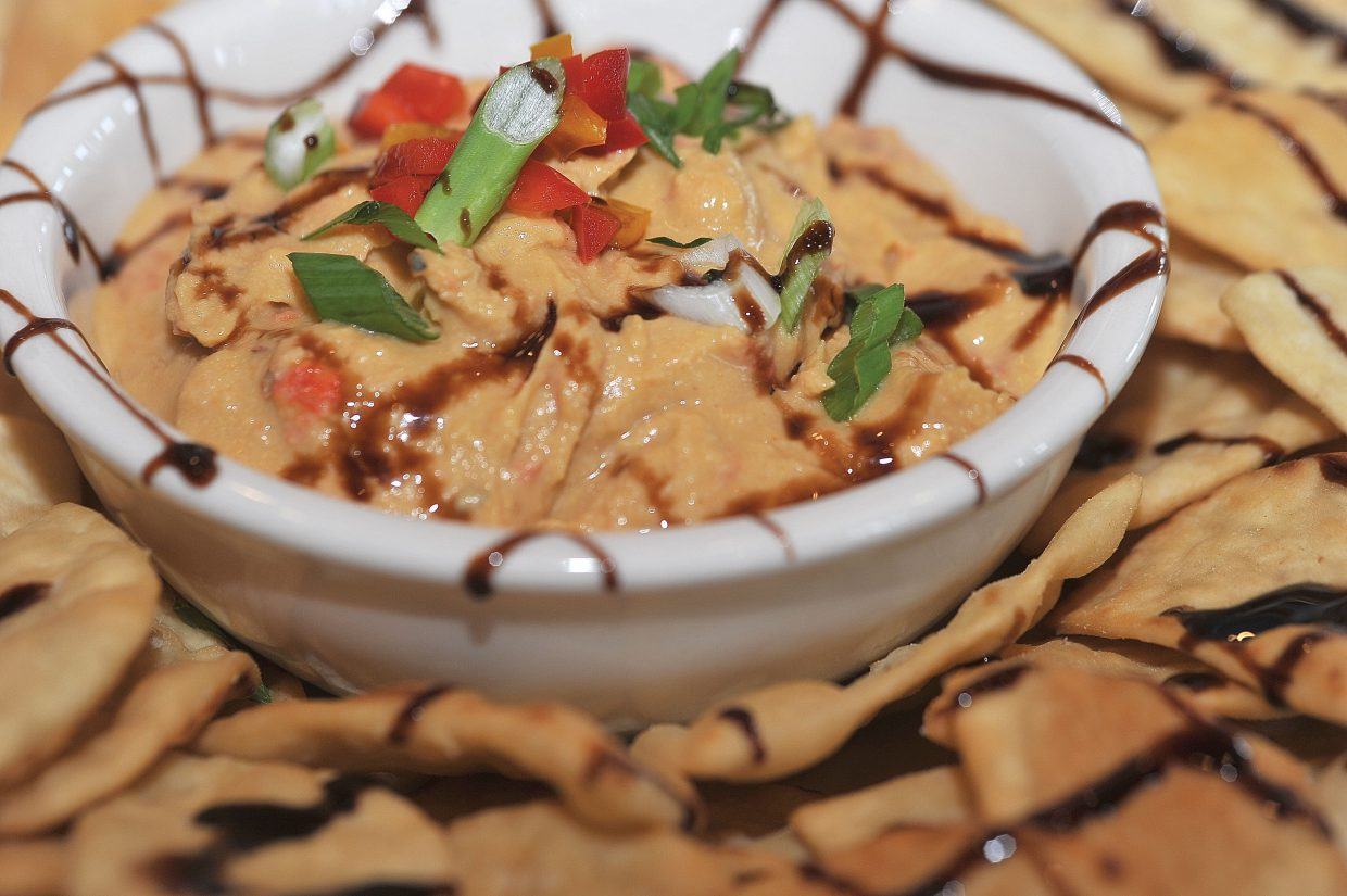 Haymaker Patio Grill offers its own twist on hummus as part of the limited lunch menu offerings currently available. The express turn window, cart service and full restaurant service will begin May 11.