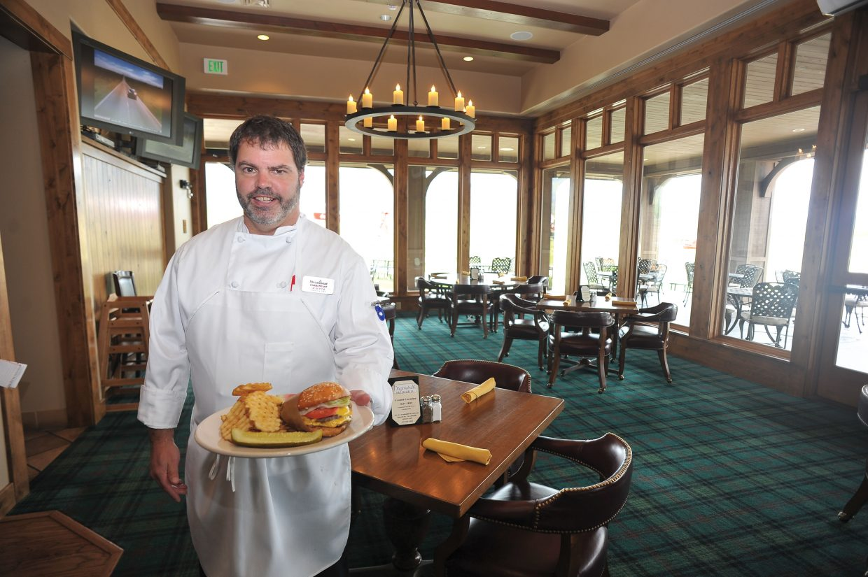 Chris Wyant, executive chef for Steamboat Ski and Resort Corp., presents the Double Boat Burger at Haymaker Patio Grill. Ski Corp. took over the operation at Haymaker Golf Course this year and eventually will serve breakfast, lunch and dinner.