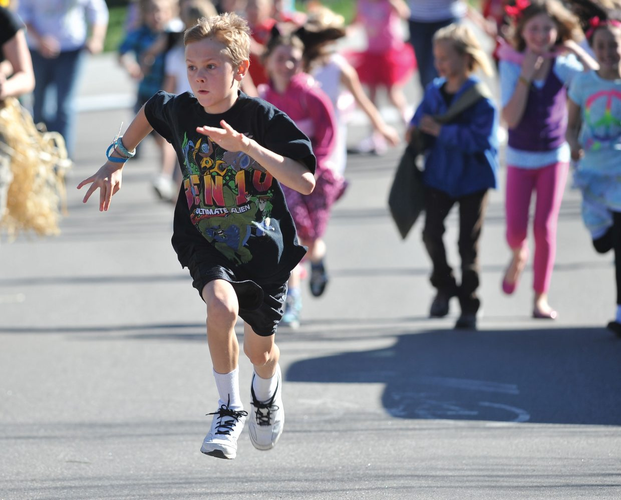 Soda Creek Elementary School student Toby Morse makes his way along Eighth Street on Friday during Jenna's Fun Run. The run was a way to celebrate the life of Jenna Gruben Morrill, who was a faculty member at the school. She died Feb. 13, 2010, in a car accident.