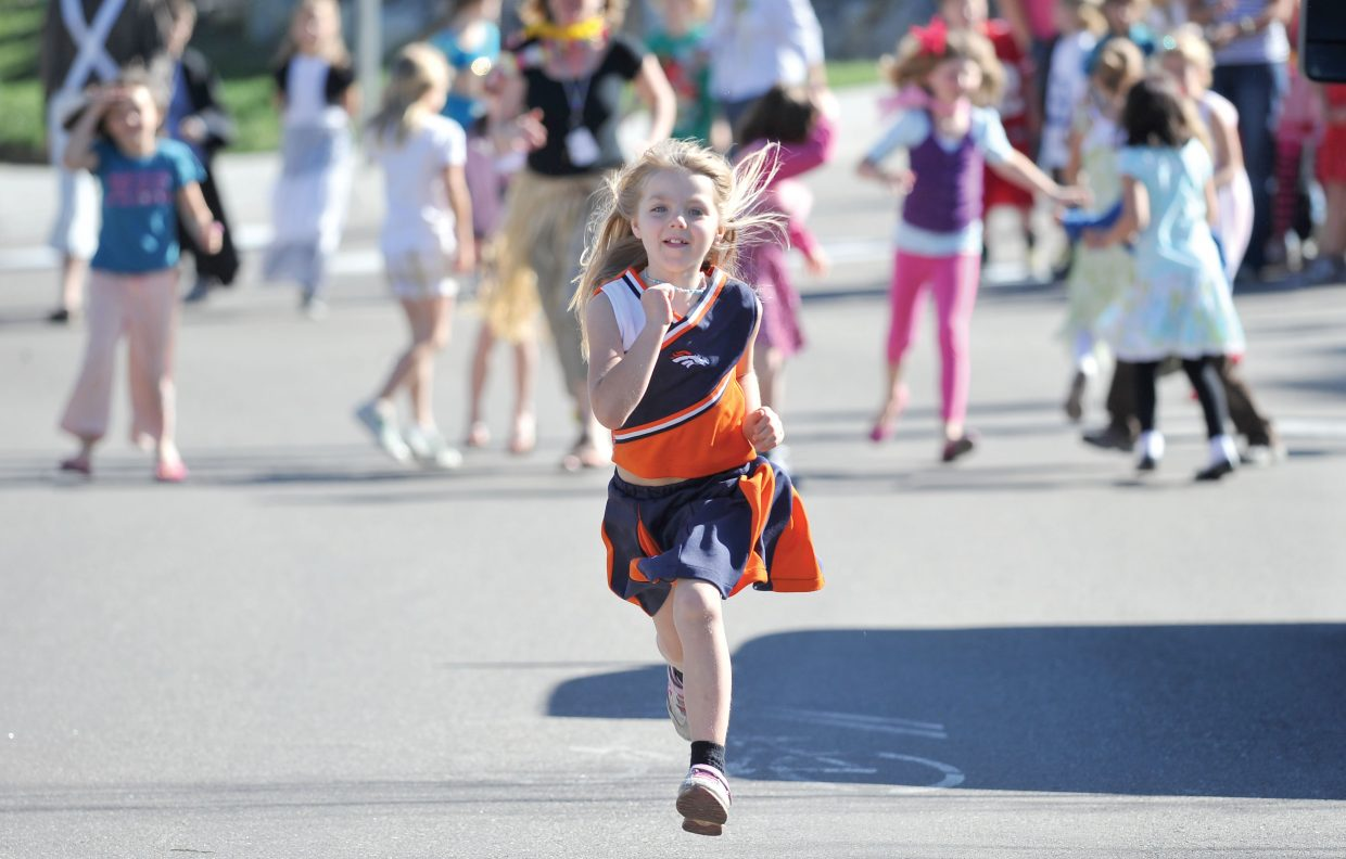 Soda Creek Elementary student Daycie Richards makes her way along Eighth Street on Friday during Jenna's Fun Run. The run was a way to celebrate the life of Jenna Gruben Morrill, who was a faculty member at the school. She died Feb. 13, 2010, in a car accident.