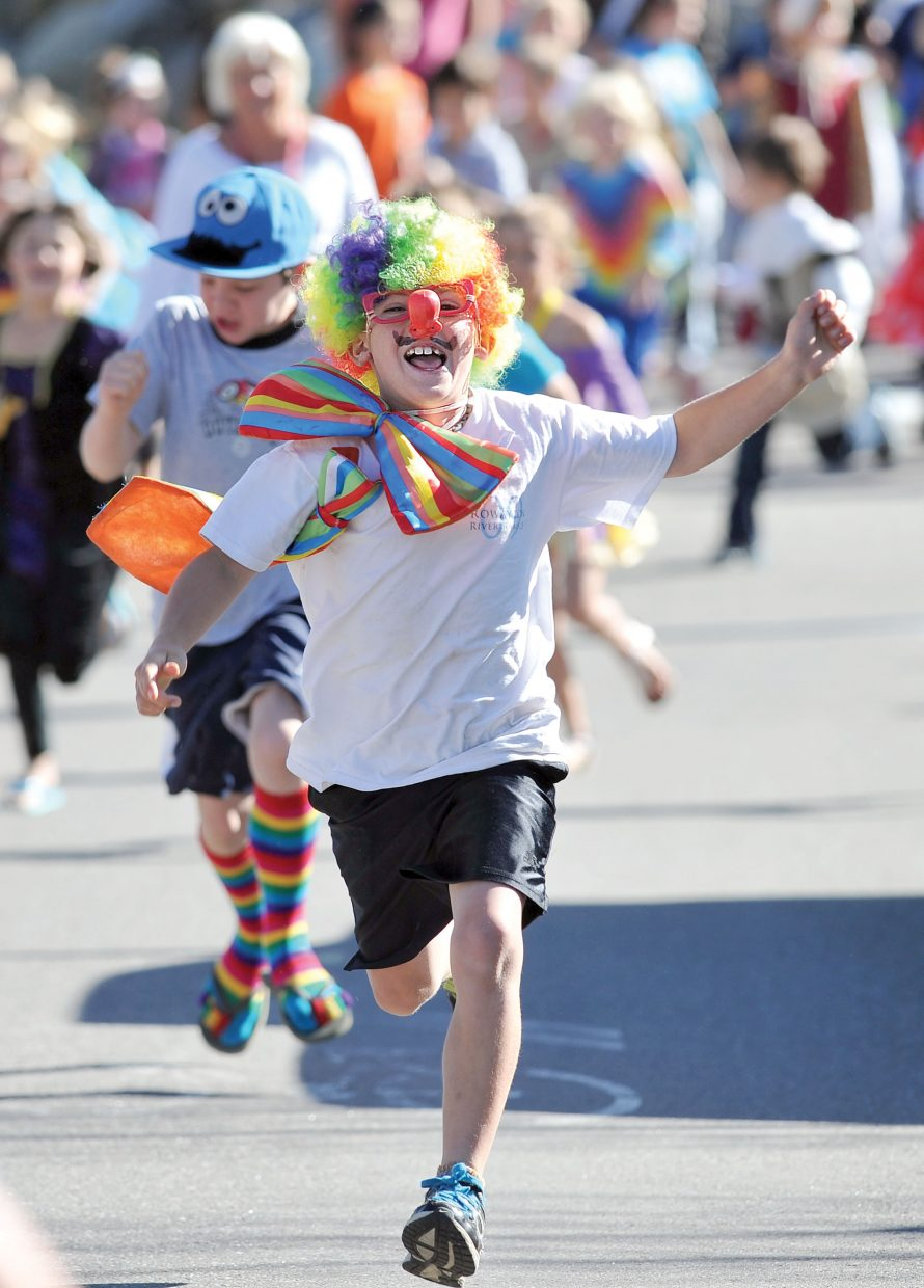 Soda Creek Elementary second-grader Max Kenney makes his way along Eighth Street on Friday during Jenna's Fun Run. The run was a way to celebrate the life of Jenna Gruben Morrill, who was a faculty member at the school. She died Feb. 13, 2010, in a car accident.