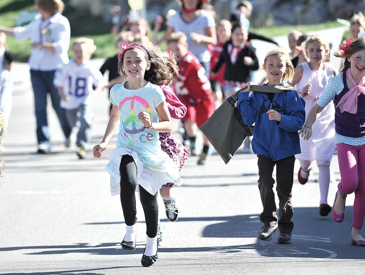 Soda Creek Elementary second-grader Makayla Kueber makes her way along Eighth Street on Friday during Jenna's Fun Run. The run was a way to celebrate the life of Jenna Gruben Morrill, who was a faculty member at the school. She died Feb. 13, 2010, in a car accident.