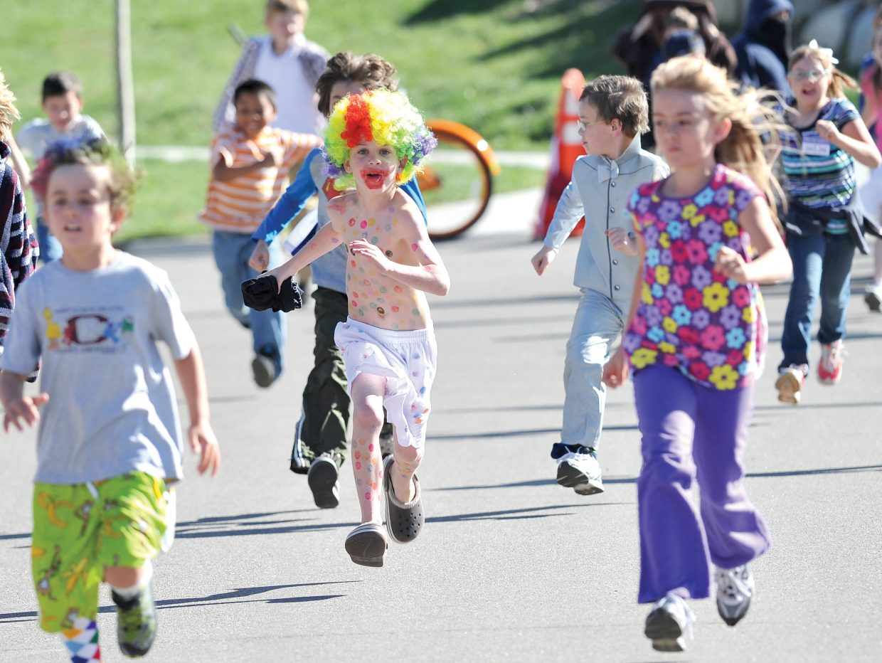 Soda Creek Elementary School student Ethan Spence makes his way along Eighth Street on Friday during Jenna's Fun Run. The run was a way to celebrate the life of Jenna Gruben Morrill, who was a faculty member at the school. She died Feb. 13, 2010, in a car accident.