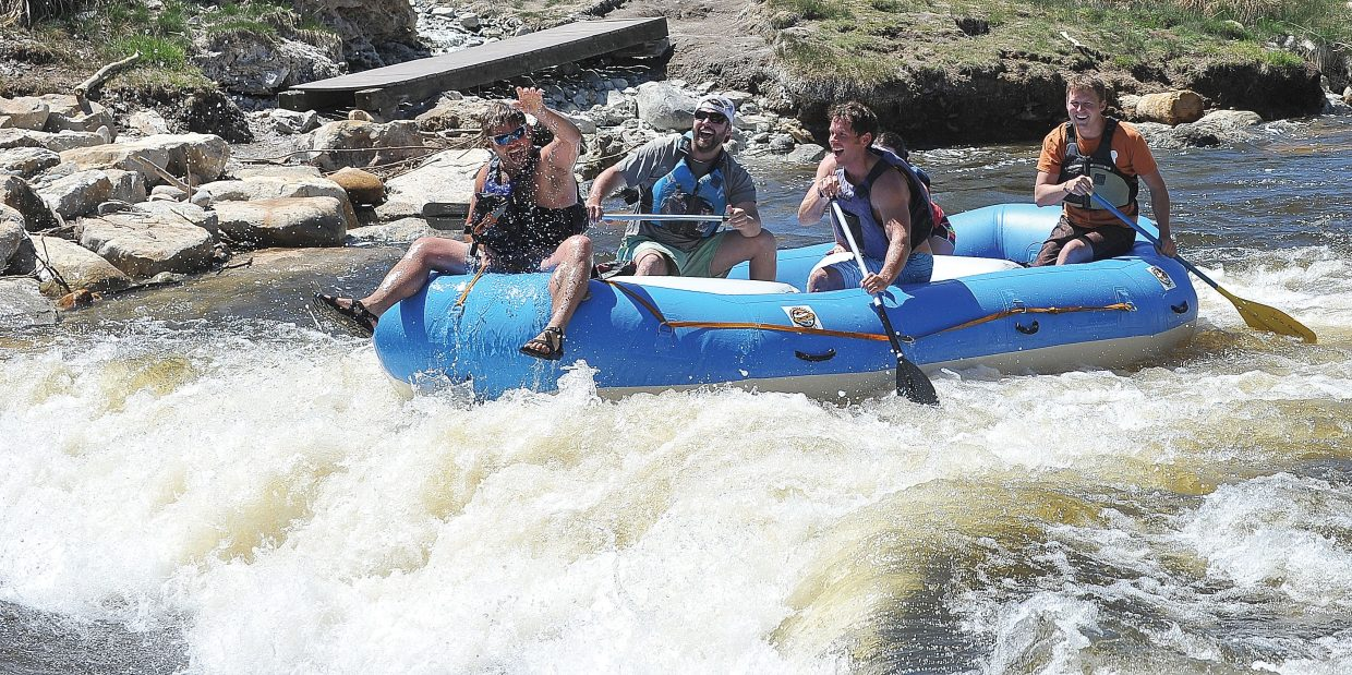 Rafters,from the front, Kyle Love, David Lathrop, Bud Whitehead, Maria Palmer (not seen) and Louis Gutschenritter run the rapids along the Yampa River. However, rafters might have a short season because of below average snowpack this year that could make for a dry summer and more demand for the valuable natural resource flowing downstream.