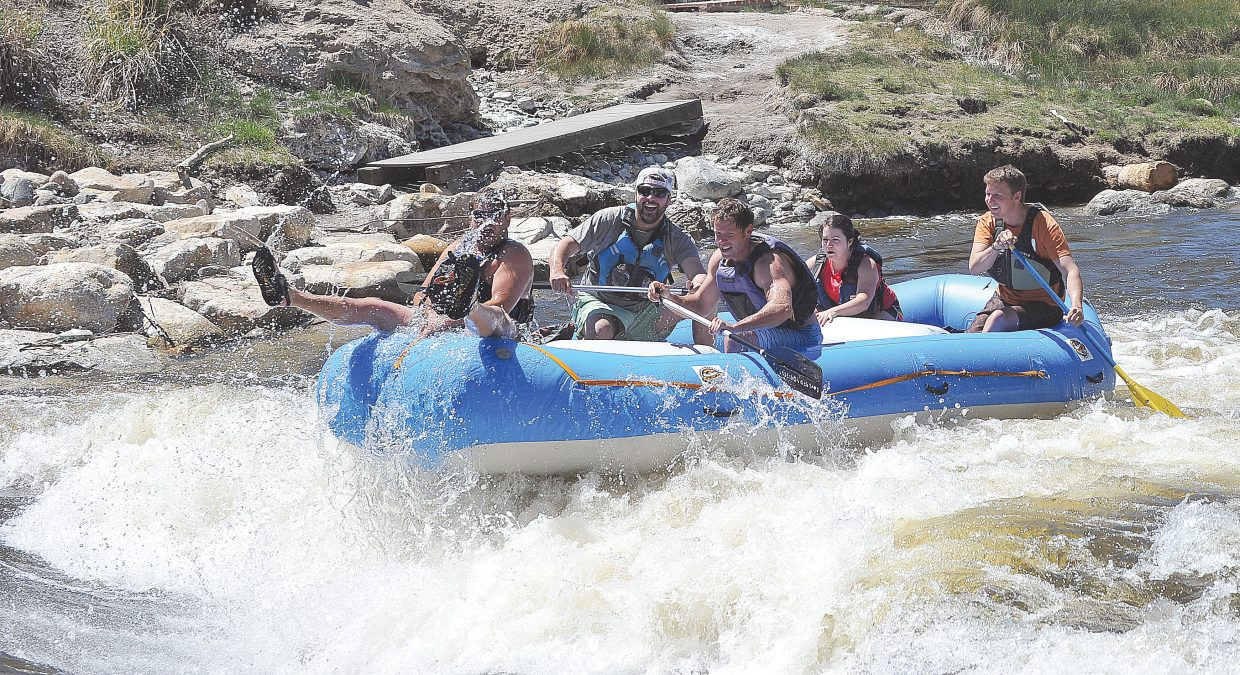 Rafters, from the front, Kyle Love, David Lathrop, Bud Whitehead, Maria Palmer and Louis Gutschenritter run the rapids along the Yampa River. However, rafters might have a short season this year because of below-average snowpack that could make for a dry summer and more demand for the valuable natural resource flowing downstream.