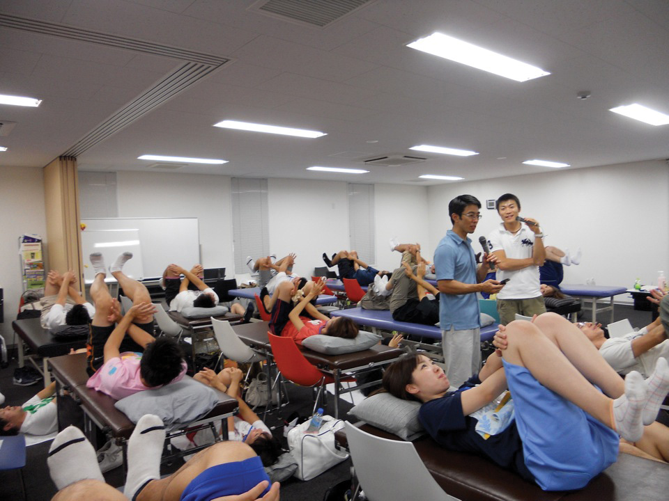 Steamboat physical therapist Brent Yamashita, left, leads participants through automatic activation of the core muscles, a component of functional manual therapy, in September 2010 in Japan. Yamashita is co-director of Johnson & Johnson Physical Therapy in Steamboat Springs and has been invited to teach in Japan.