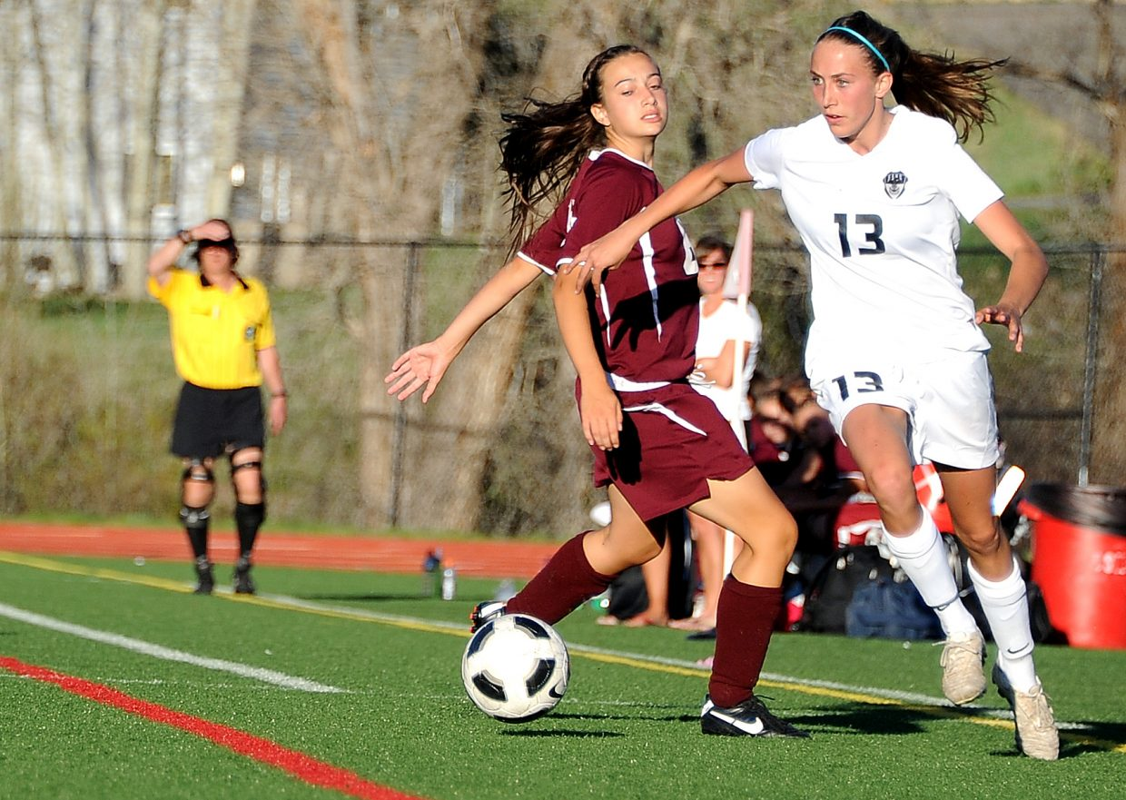 Steamboat's Sydney Bauknecht flies by a Palisade defender Friday as she heads for the goal. Bauknecht finished the game with a hat trick, taking care of all the scoring in Steamboat's 3-0 victory.
