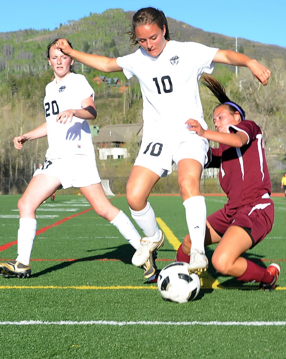 Steamboat's Katie Hostetler wins the race for a loose ball Friday as the Sailors beat Palisade, 3-0.