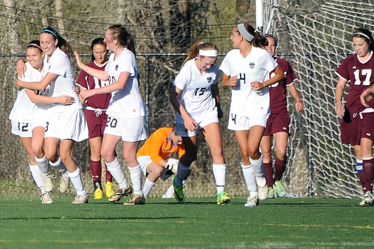 Sydney Bauknecht, second from left, and the Sailors celebrate after the first of Bauknecht's three Friday night goals.
