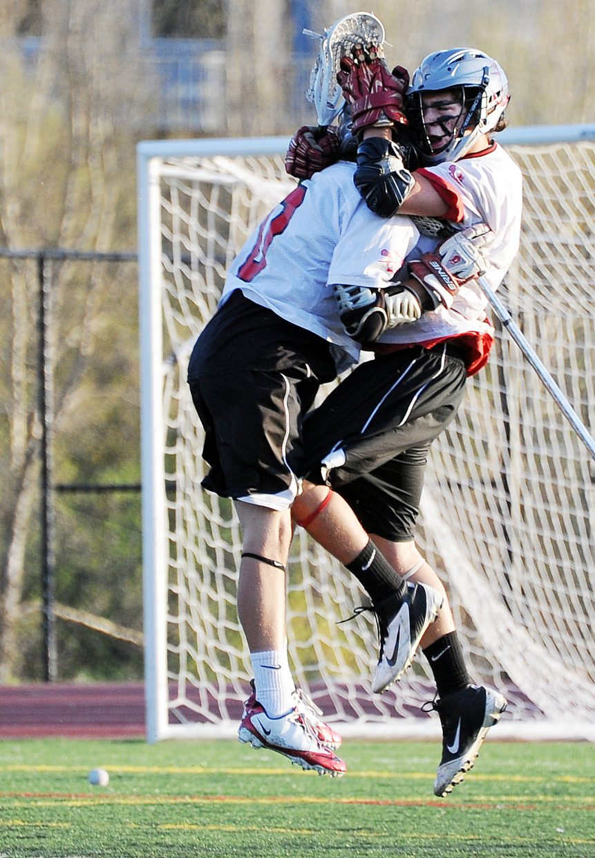 Steamboat's Ben Wharton, left, and Christian Ramirez celebrate after a goal Saturday against Denver East. The Sailors won the game, 9-4.