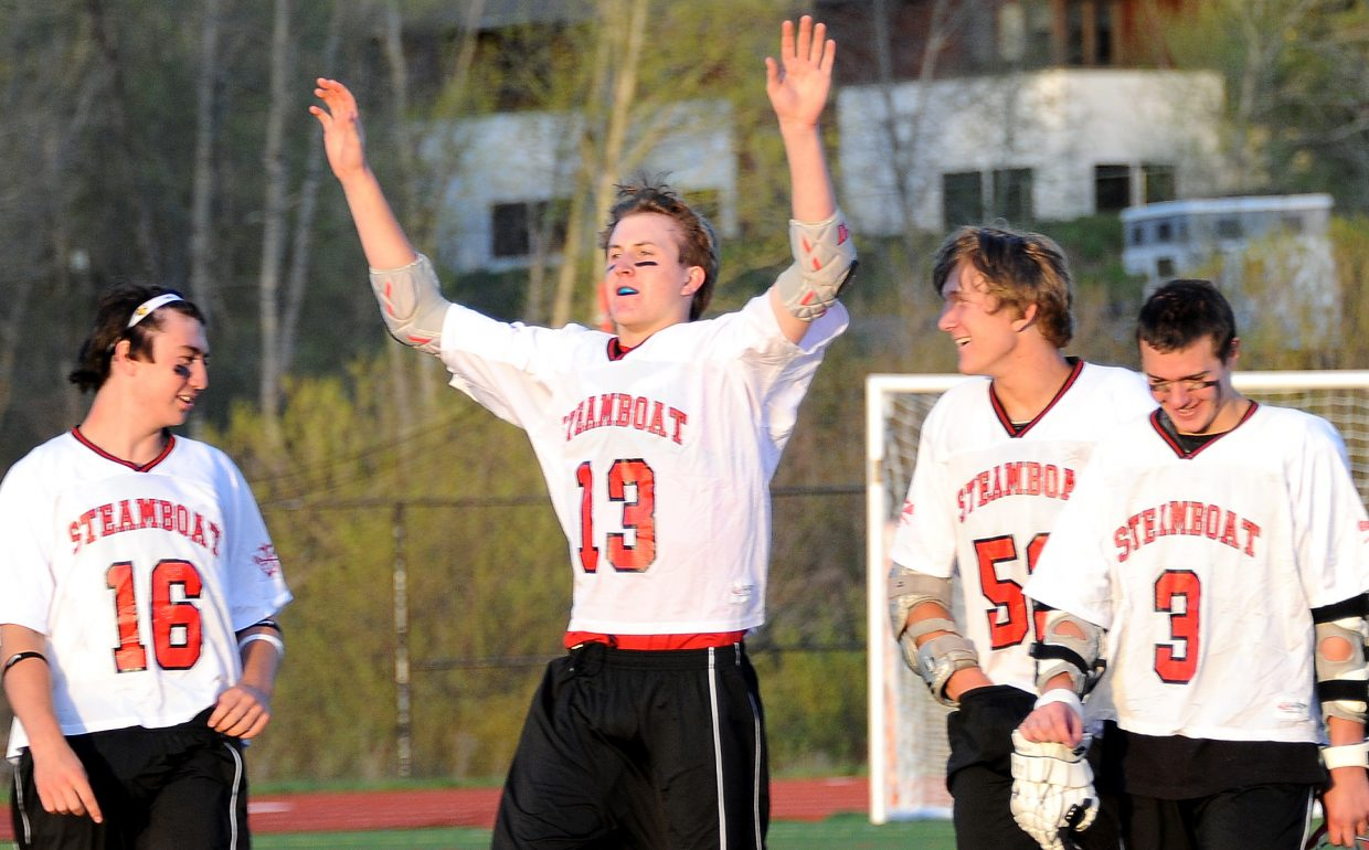 Steamboat's Penn Lukens raises his arms after Steamboat's 9-4 playoff victory on Saturday.