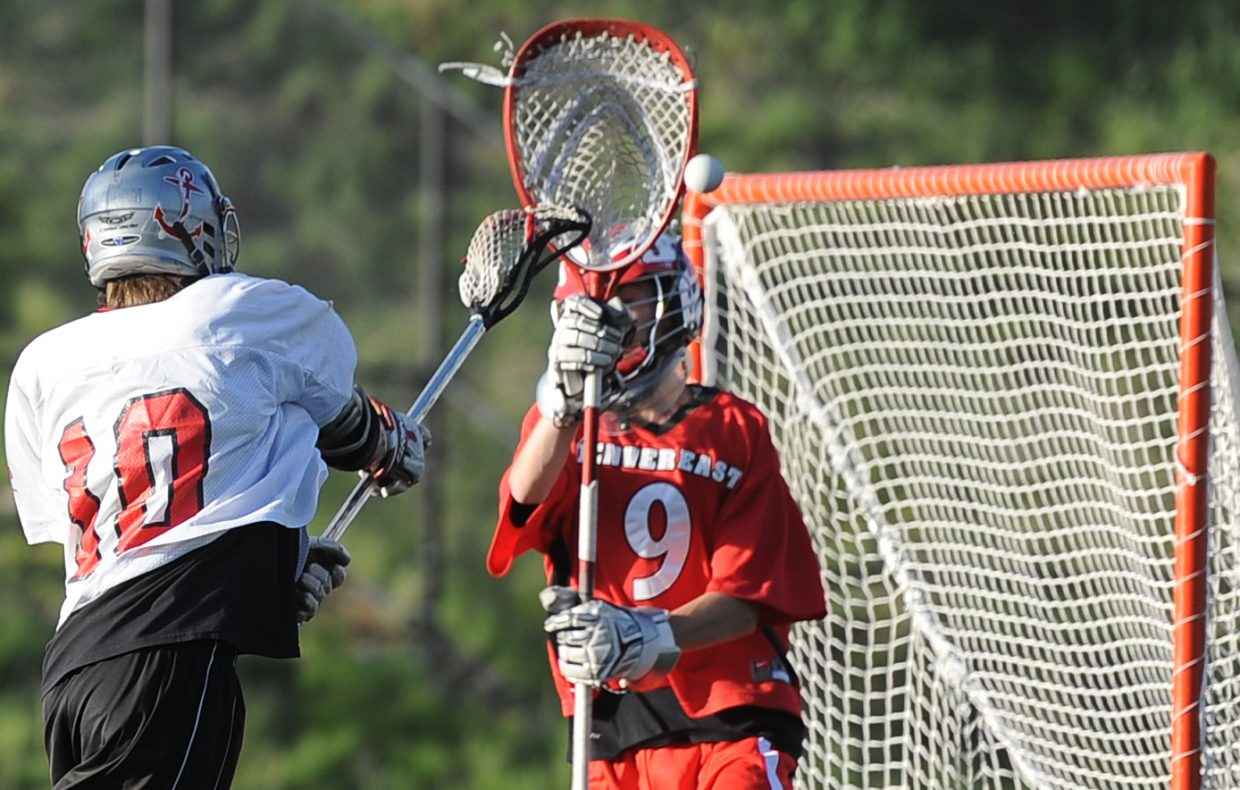 Steamboat's Ben Wharton throws the ball by the Denver East goalie Saturday. He scored on the play.