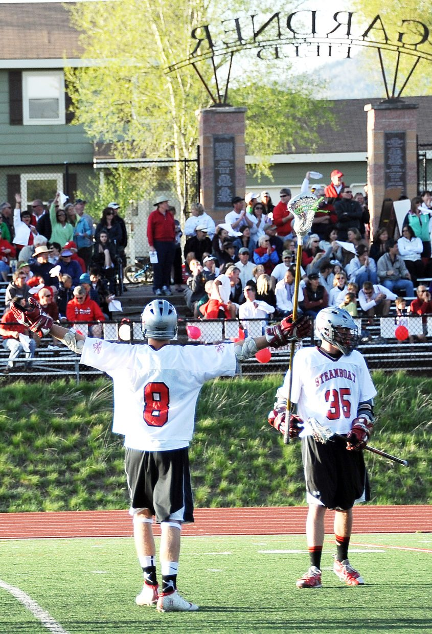Steamboat Springs senior Aleck Gantick calls to the crowd late in Saturday's 9-4 playoff victory against Denver East.