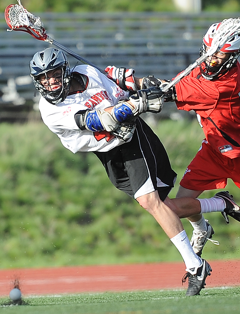 Steamboat's Wilber Ranieri launches a shot against Denver East on Saturday. Steamboat won the game, 9-4.
