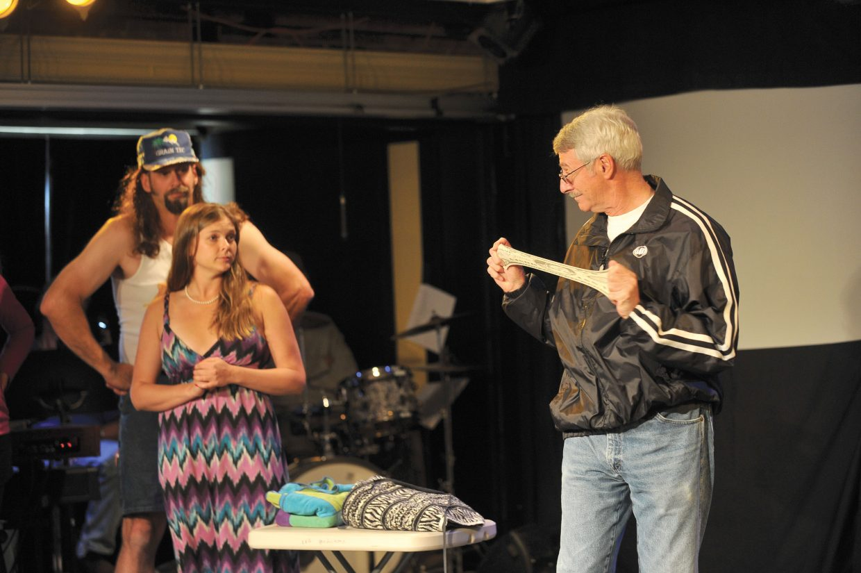 Actor Cesare Rosati plays out a scene with Kasey Lane Ham, middle, and Chad McGown, far left, during a rehearsal for this year's performance of Caberet 2012.