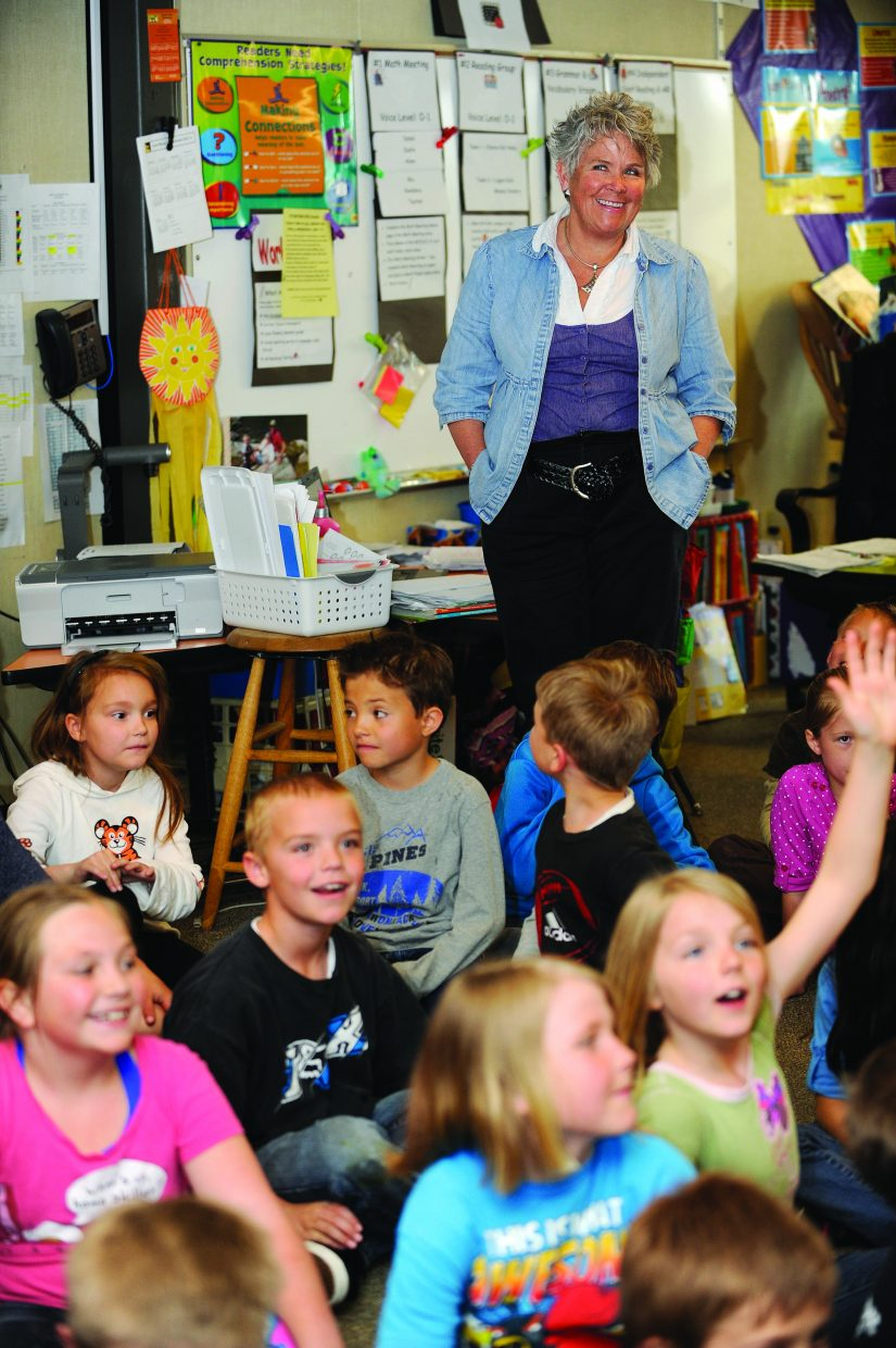 Hayden Valley Elementary School teacher Kathy Deepe smiles as she is acknowledged as a Peabody Energy Leader in Education on Wednesday in her classroom. Deepe is heavily involved in the school district's drama program and was acknowledged for teaching her students how to embrace and appreciate their true abilities. At the end of the school year, she writes a poem for each of her outgoing students. For her dedication to teaching, Deepe was given $1,000.