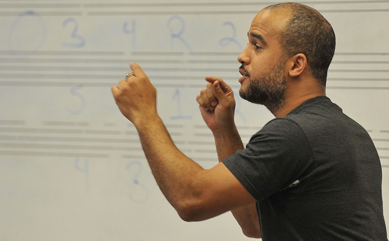 Daniel Bernard Roumain, a classically trained composer, performer and violinist, works with high school band students Tuesday in Steamboat Springs. He will perform Friday at Strings Music Pavilion and is the featured artist for the 2012-13 Strings School Days outreach program.
