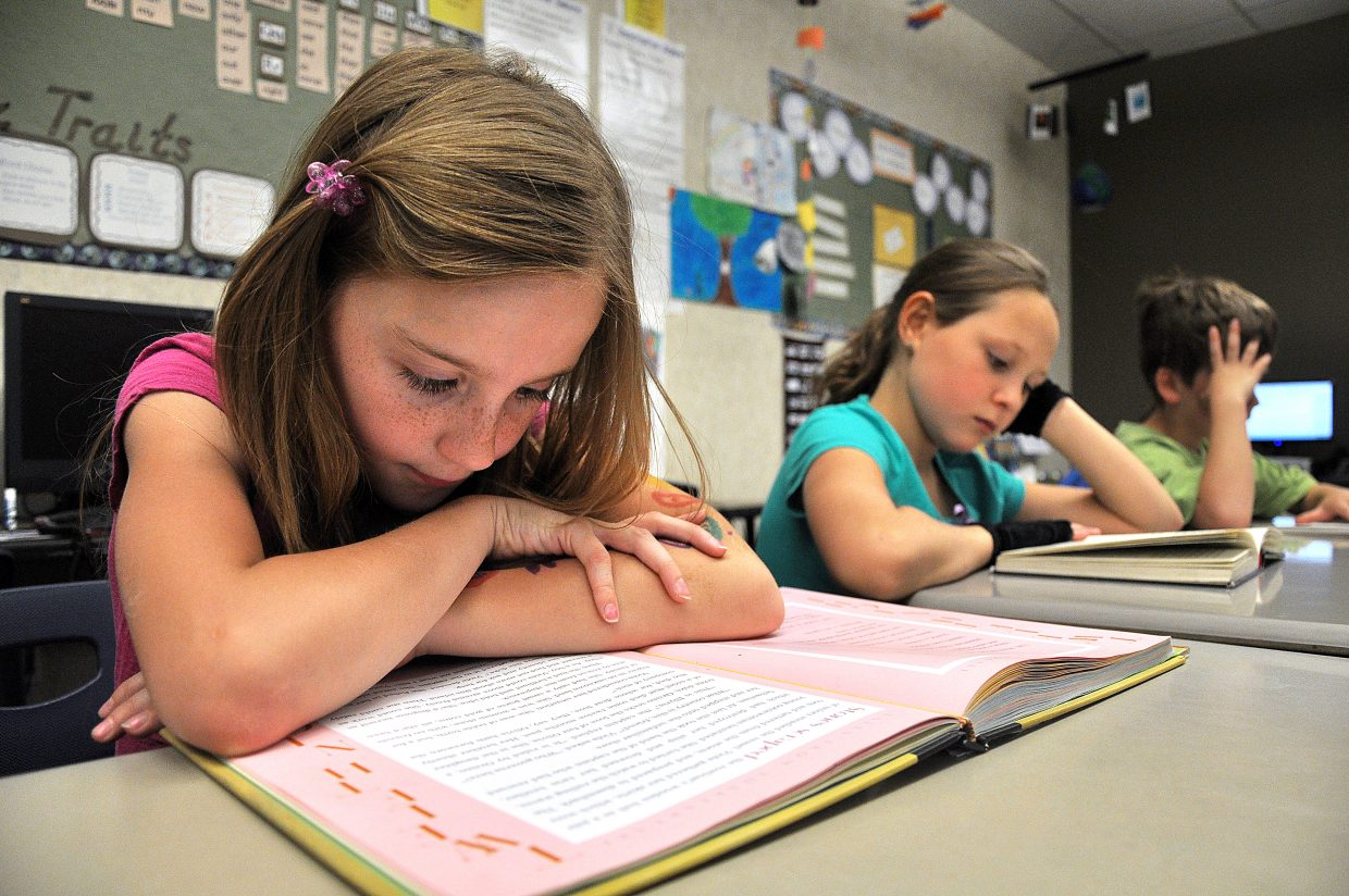Morgan Graham, a third-grader at Soda Creek Elementary School, reads Wednesday afternoon during class. Steamboat's third-graders posted record scores on this year's state reading test.