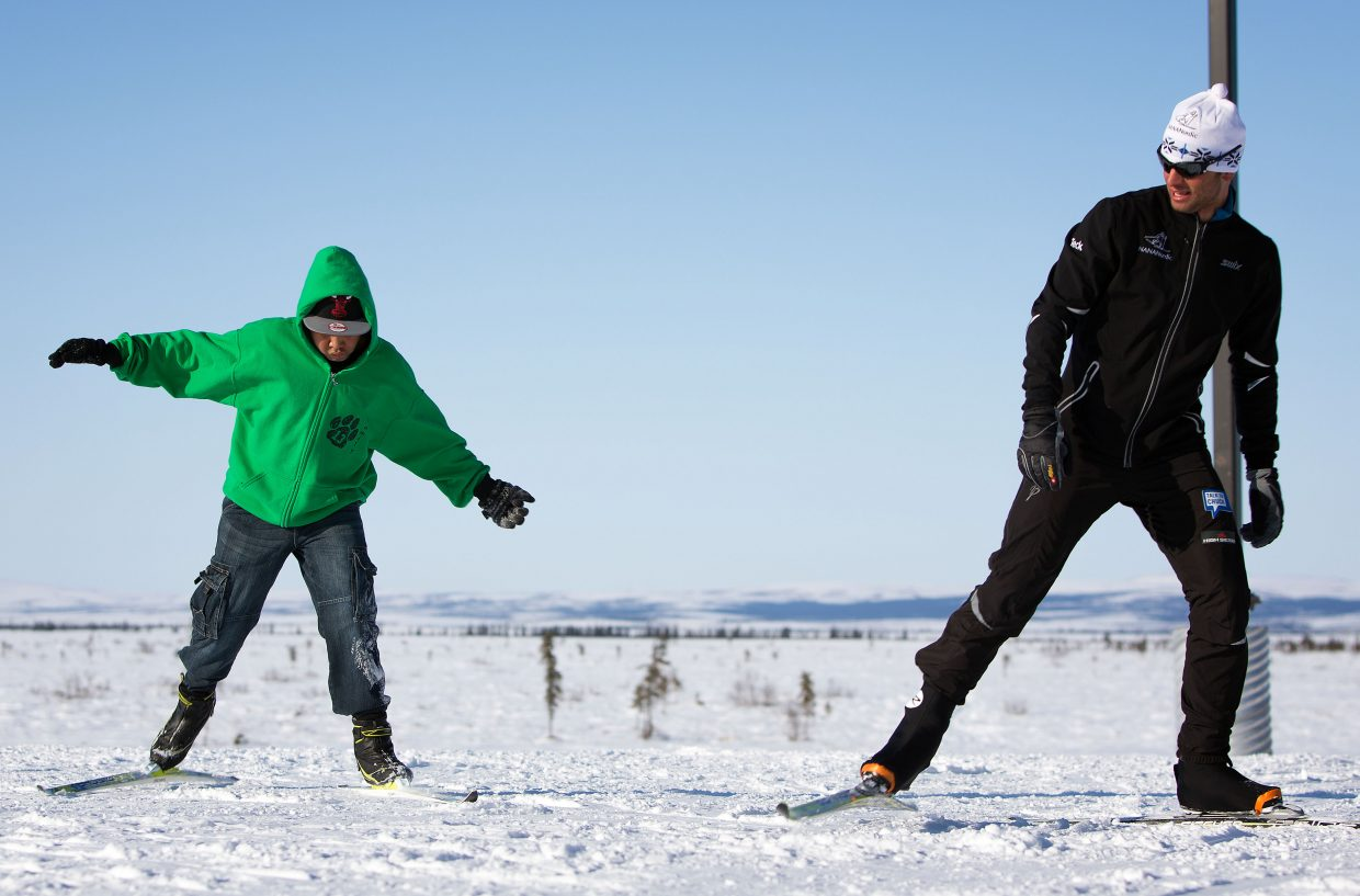 Steamboat Springs Winter Sports Club coach Josh Smullin helps teach a young skier the sport last month during a trip to Alaska with the NANANordic program, which seeks to bring the sport of skiing to Alaska's remote villages.