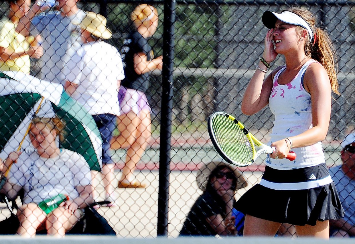 Steamboat Springs senior Summer Smalley winces after a shot Thursday at the state tennis tournament in Pueblo. It was a rough day for the Sailors, as all seven entries in the tournament, 11 players, lost. Four entries can get back in the tournament Friday via playback opportunities.