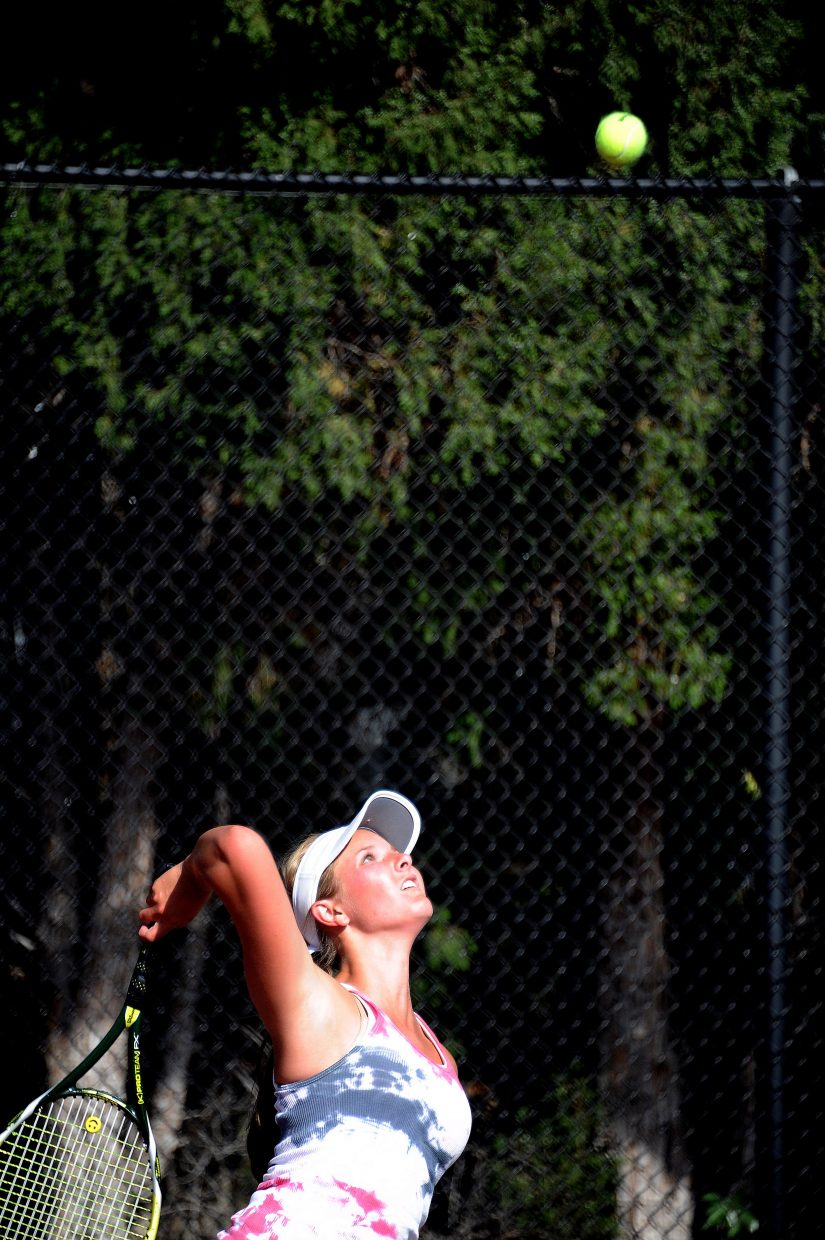 Steamboat's Brooke Metzler swings for a serve Thursday in Pueblo.