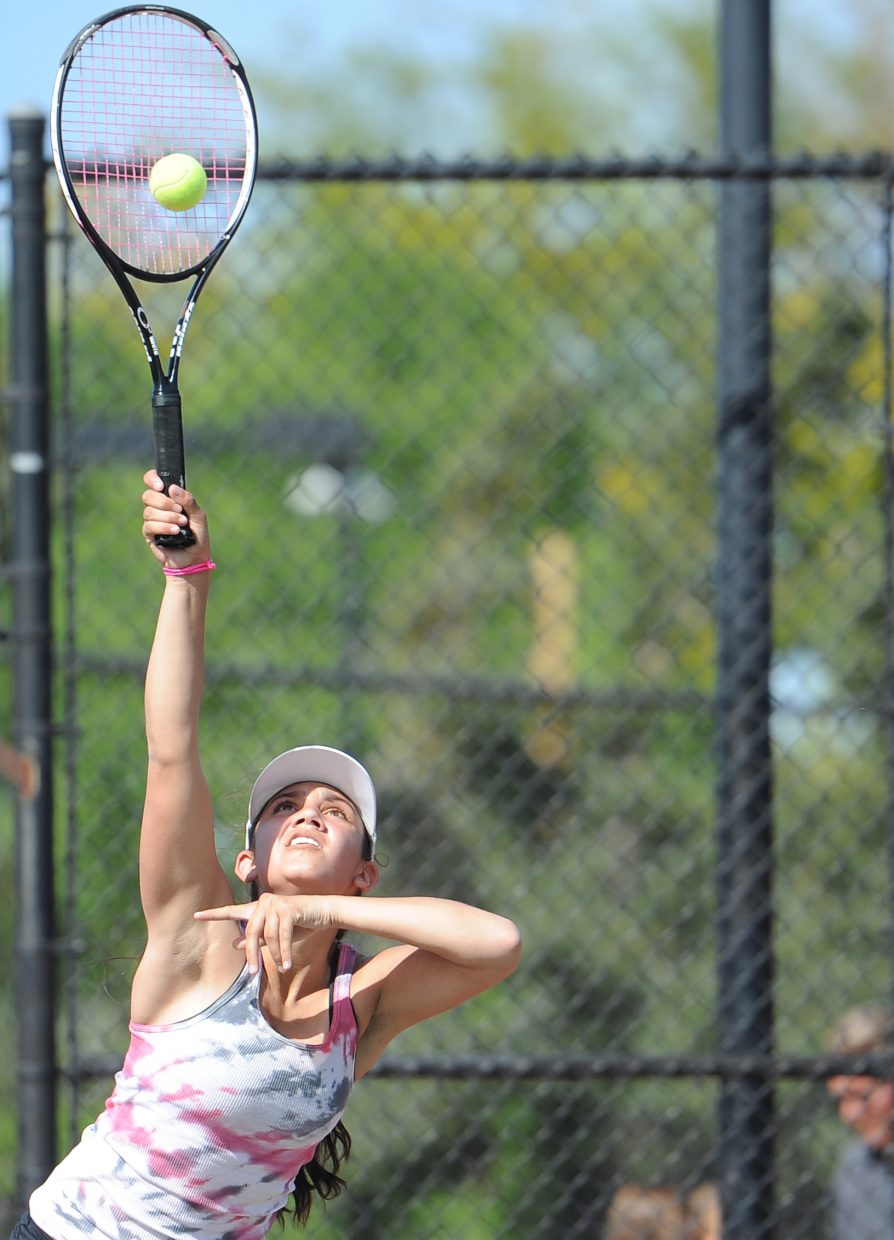 Steamboat's Shealie Jenkins knocks a serve Thursday in Pueblo.