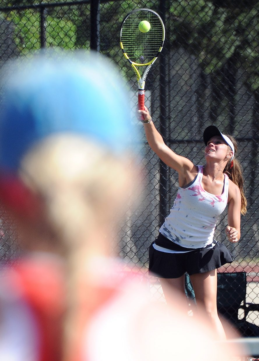 Steamboat's Summer Smalley serves to her opponent Thursday at the state tennis tournament in Pueblo.
