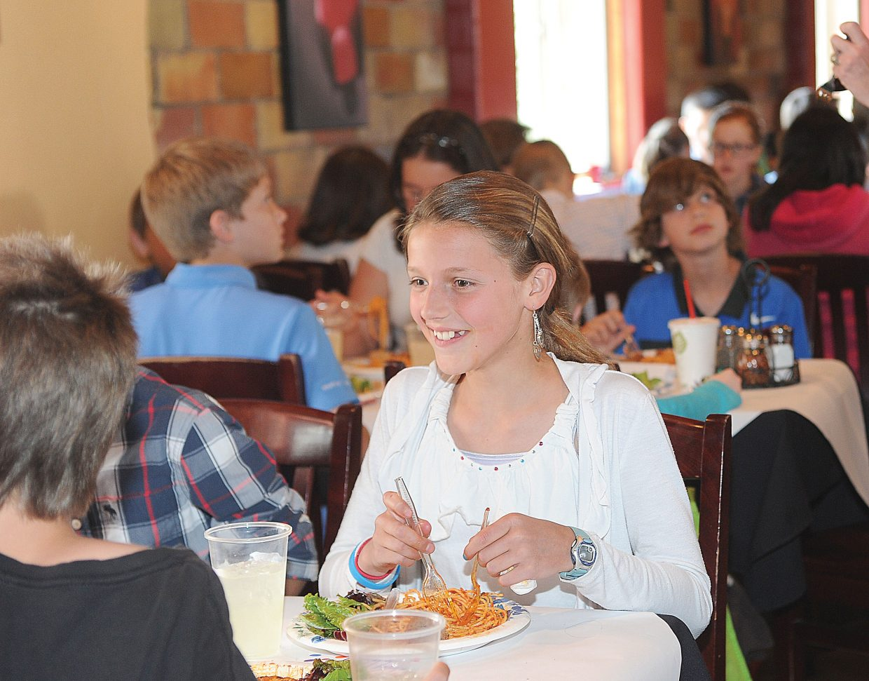 Fifth-grader Riley Hodges takes part in Soda Creek Elementary School's formal luncheon at Mambo Italiano on Friday. The luncheon is the culmination of etiquette lessons taught by Molly Hayes.