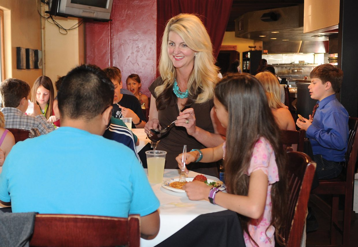 Molly Hayes, also known as Molly Manners, takes part in Soda Creek Elementary School's fifth-grade formal luncheon at Mambo Italiano on Friday. The meal also is a celebration for the children who are making the transition to middle school.