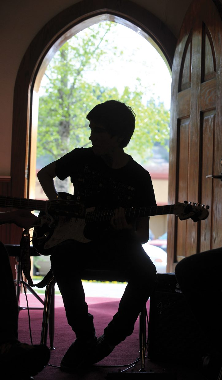 Guitarist Cole Zander plays a song during a jam session Thursday evening at St. Paul's Episcopal Church.