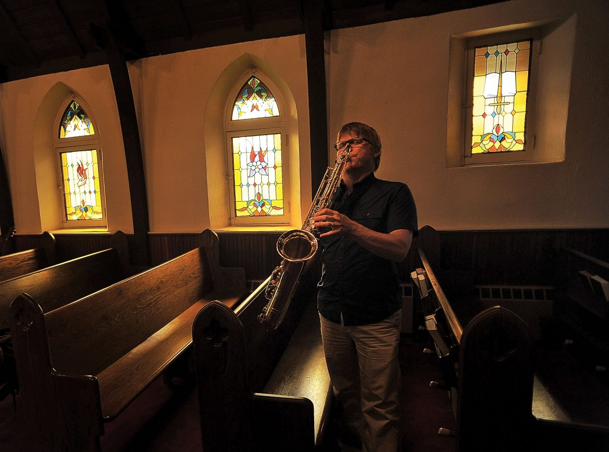 Saxophone player Darren Zander plays a song during a jam session Thursday evening at St. Paul's Episcopal Church.