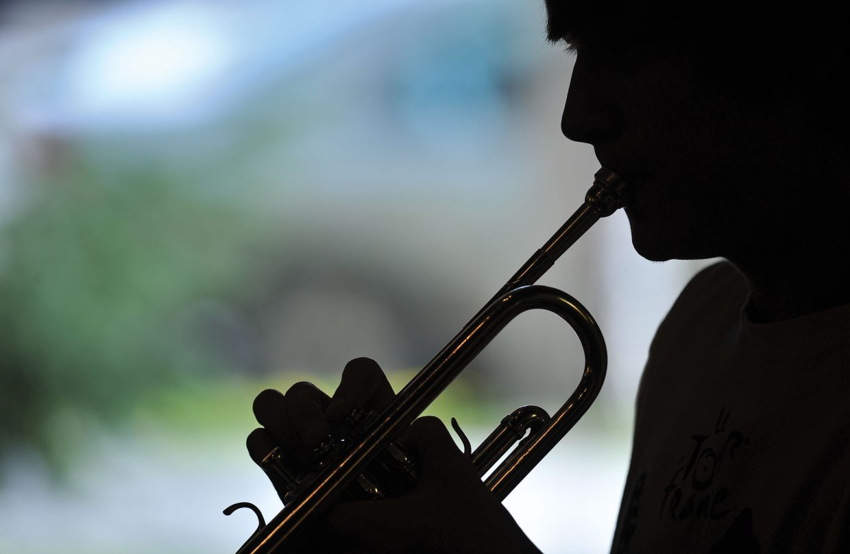 Trumpet player Christian Poirot plays a song during a jam session Thursday evening at St. Paul's Episcopal Church.