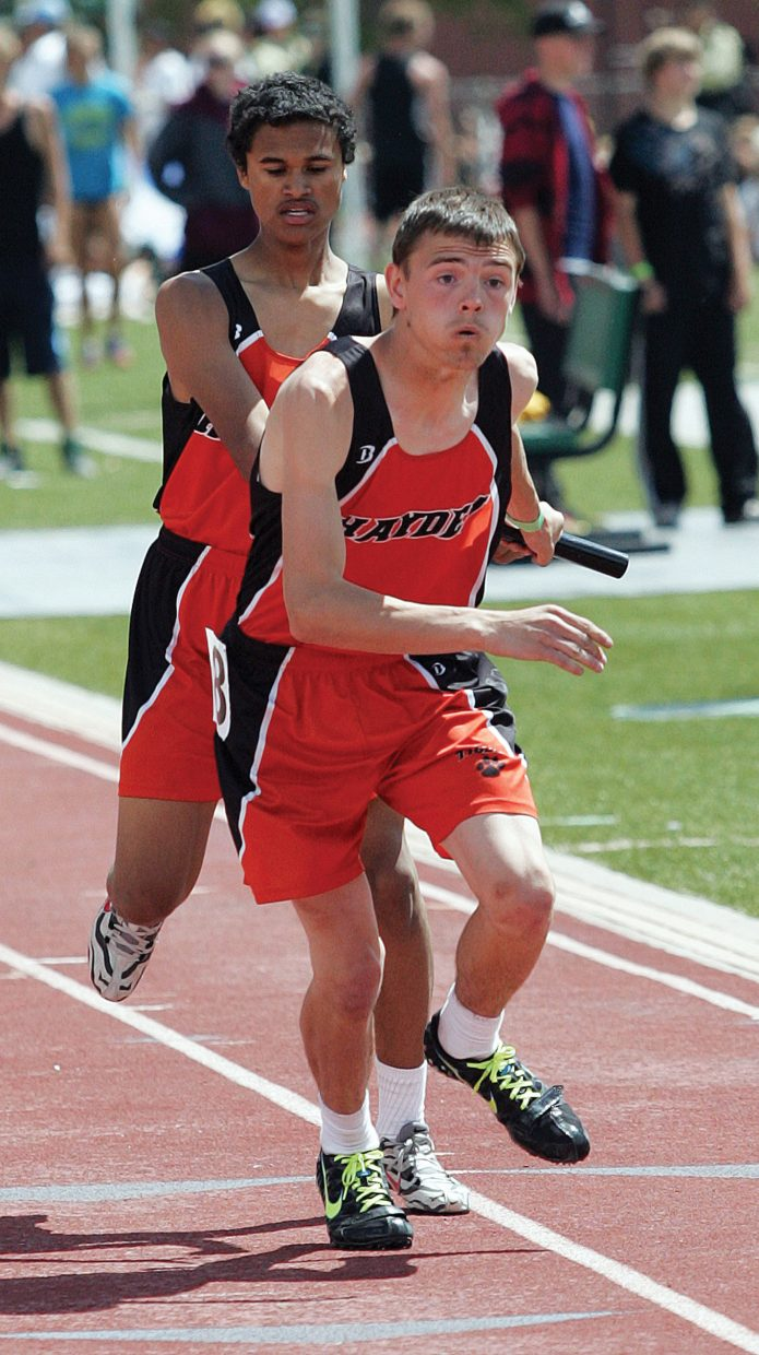 Hayden's Brentt Gabel takes the baton in the boys 1,600-meter relay Friday in Grand Junction. The Tigers placed seventh in the event. Hayden and Soroco find out Sunday how many athletes they'll field at the state meet, which begins Thursday.
