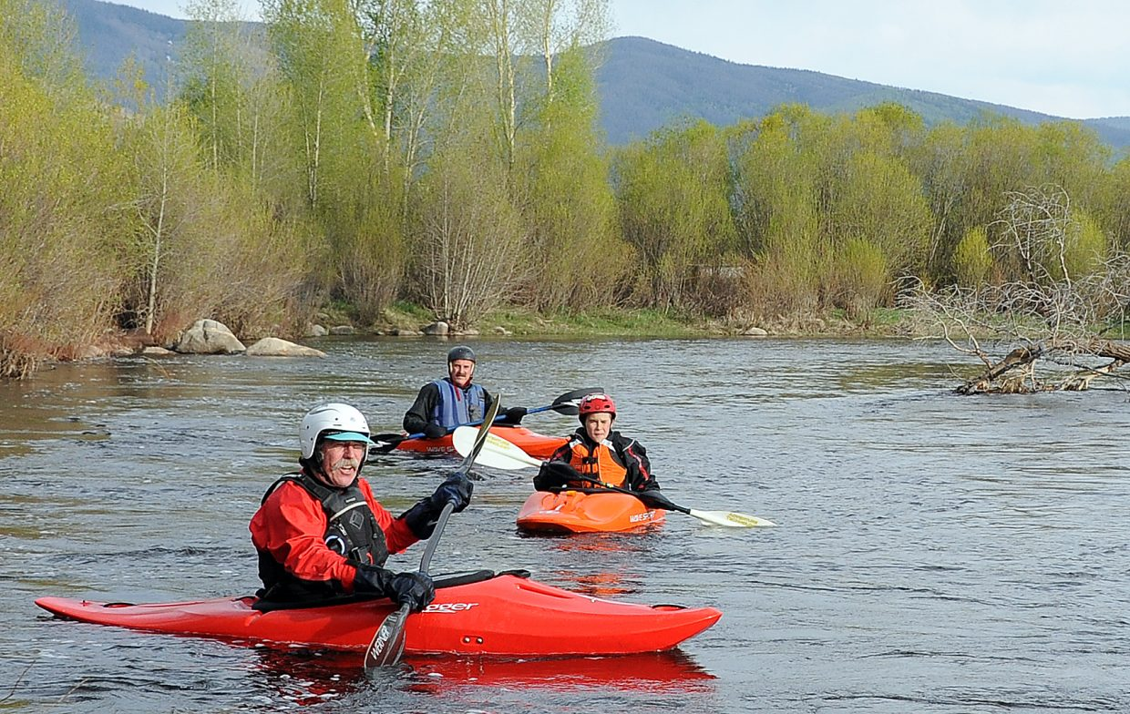 Barry Smith leads Spencer Schlegel, middle, and Gary Schlegel down the Yampa River on Saturday afternoon. Kayakers aren't expecting a big season, but they said that so far, conditions have been as good as possible, considering the lackluster winter snowfall totals.