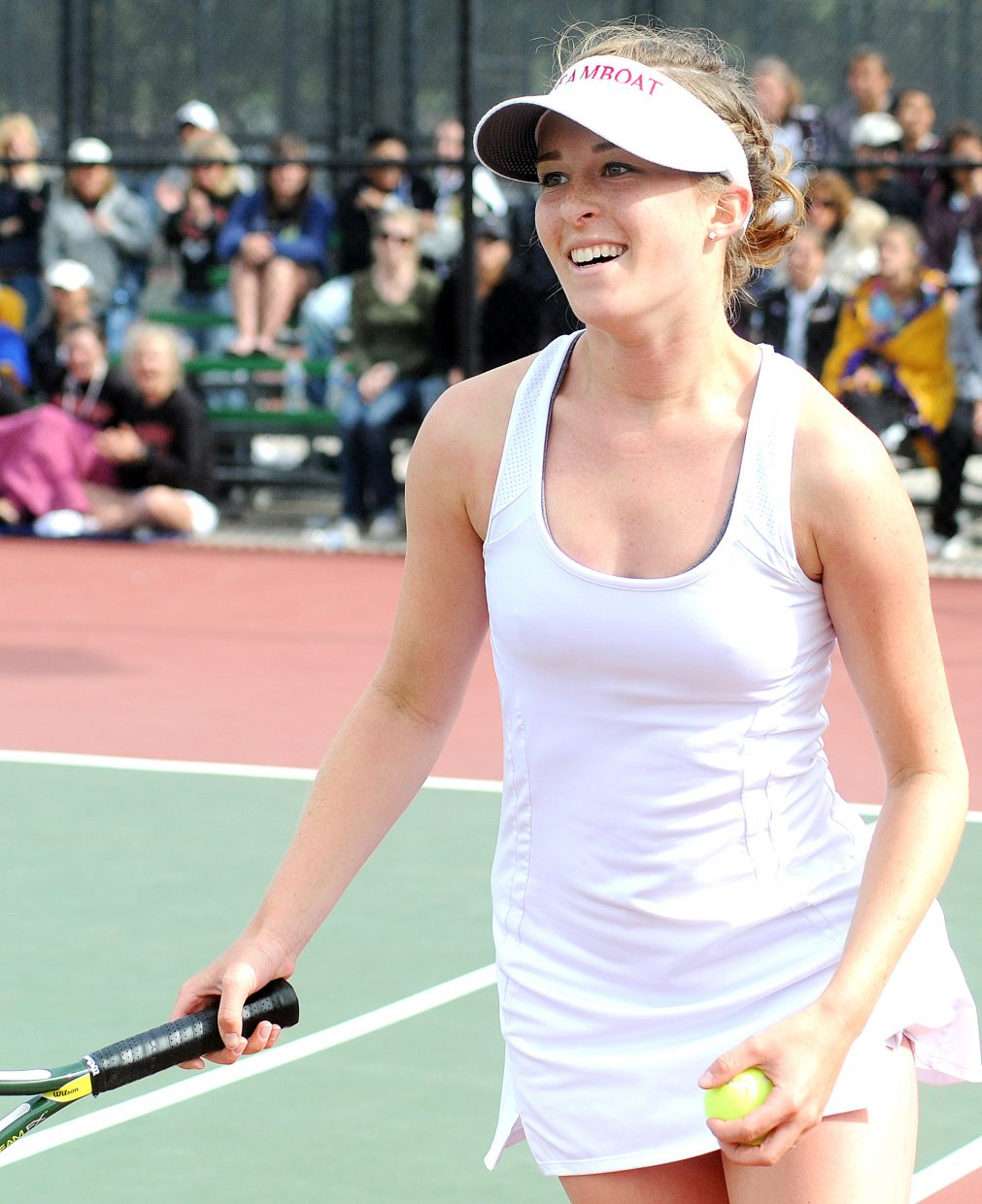 Kylee Swiggart smiles wide after winning the final point of her quarterfinal match at the state tennis tournament in Pueblo. Swiggart is the only Sailor who advanced to today's state semifinals.