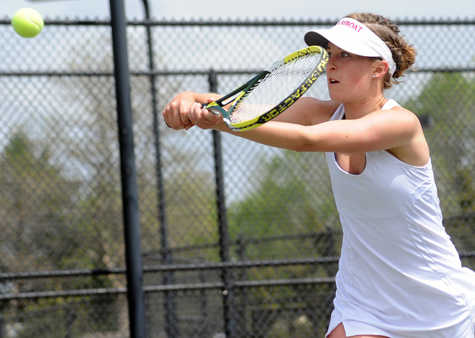 Kylee Swiggart eyes the ball at the state tennis tournament in Pueblo on Thursday.