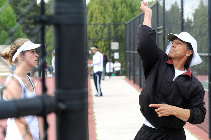 Kylee Swiggart watches as Steamboat coach John Aragon demonstrates a serve Thursday at the state tennis tournament.