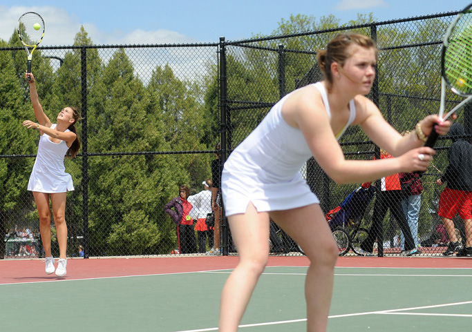 Summer Smalley serves as Katie Ross waits Thursday at the state tennis tournament in Pueblo.