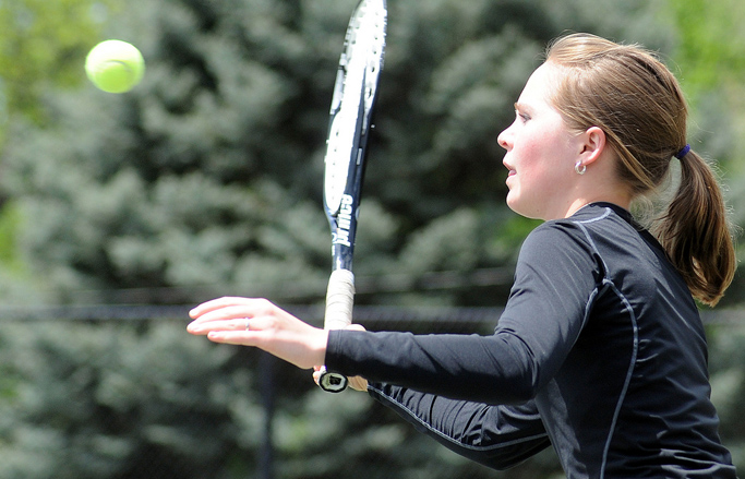 Ali Diehl swings for a return on Thursday at the state tennis tournament.