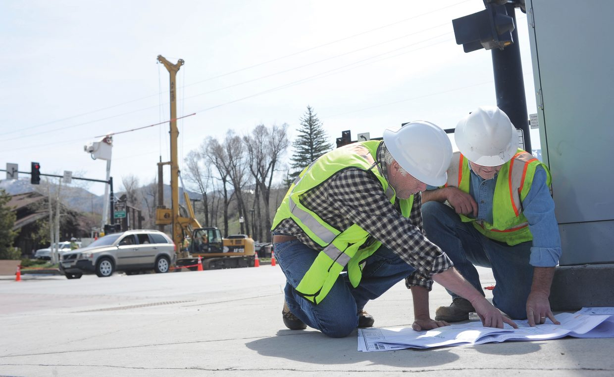 Scott Munroe, of McPherson Contracting, and Steve Holmberg, of Frontier Structures, work on marking the intersection at Third Street and Lincoln Avnue as an improvement project gets underway in Steamboat Springs.