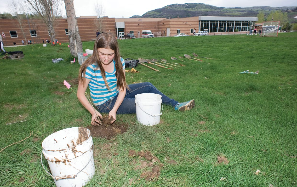 Steamboat Springs Middle School student Lauren Requist plants trees in front of the high school Wednesday as part of Routt County United Way's Day of Caring.